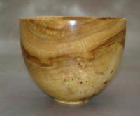 "Spalted Maple Bowl - This spalted maple bowl is 7"" tall and about 5"" wide. This bowl shows some varied and unique grain patterns not always found in a single piece of wood."